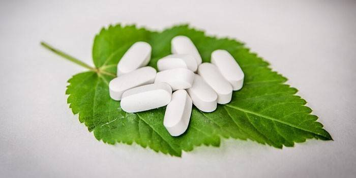 Таблетки білого кольору